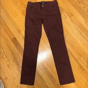 American eagle stretch skinny maroon pants